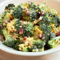 Bodacious Broccoli Salad Recipe - Chopped broccoli, crumbly bacon, lots of grated cheese, and red onion are tossed with a lovely red wine vinegar and mayonnaise dressing. The salad needs to chill at least an hour or two before serving.
