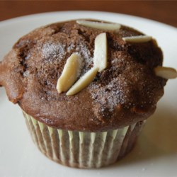 Chocolate Chocolate Chip Nut Muffins Recipe - Double chocolate muffins with walnuts on the inside and almonds stuck into the tops!