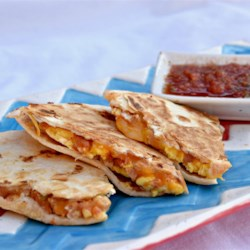 Breakfast SPAM(R)adillas Recipe - A delicious breakfast quesadilla on flour tortillas featuring SPAM(R) with Bacon, eggs, Colby-Jack cheese, and salsa.  