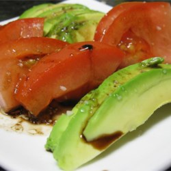 Tomato and Avocado Salad Recipe - A very simple, very delicious salad, that makes a perfect starter for dinner parties.