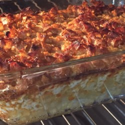 Potato Casserole Recipe and Video - This simple-to-assemble casserole is rich and buttery in flavor with a crispy top, thanks to the crushed corn flakes.