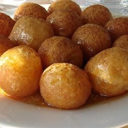 Loukoumades Recipe - These little yeast-risen dough puffs are deep-fried to a golden brown, then drizzled with honey syrup and sprinkled with cinnamon. They're popular all around the Mediterranean, especially in Greece, and are beloved as a Hanukkah treat among Sephardic Jews.