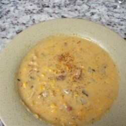 Corn Chowder IV Recipe - Potatoes, bacon and creamed corn are combined with margarine, evaporated and whole milks in this chowder thickened with processed cheese.
