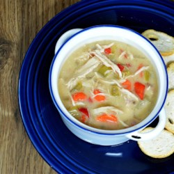 Easy Slow Cooker Chicken Soup Recipe - An easy, creamy chicken soup simmers in the slow cooker all day for a warm and flavorful meal on a cold winter night.