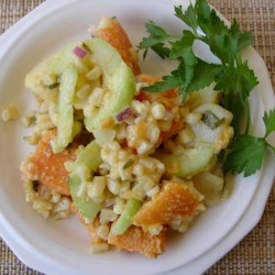 Caribbean Sweet Potato Salad Recipe - This recipe includes white potatoes as well as a bevy of other fabulous ingredients -  peanuts, corn, cucumber and red onion. The dressing is oil-based with a splash of lime juice and chopped fresh cilantro.