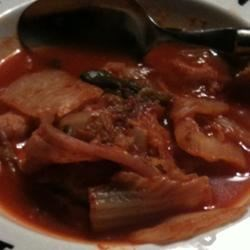 Korean Kimchi Jigeh Stew Recipe - A favorite in the dorms, this easy to prepare soup is the spicy college counterpart to the bowl of instant noodles.  It is delicious served with cooked rice.