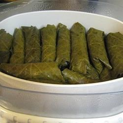 Stuffed Grape Leaves (Dolmades) Recipe - These stuffed grape leaves are filled with ground lamb, fresh mint, and pine nuts. Enjoy them as a main dish or as a meze (appetizer).