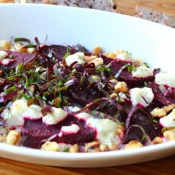 Roasted Beets with Goat Cheese and Walnuts Recipe and Video - Sweet and earthy roasted beets team up with crunchy toasted walnuts and creamy goat cheese to make a warm salad for a delightful fall lunch or side dish.