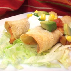 Chicken Flautas Recipe - Lightly crisped corn tortillas are stuffed with a zesty chicken and cheese filling.