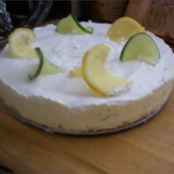 Daiquiri Chiffon Cheesecake with Pretzel Crust Recipe - Daiquiris on a tropical beach. That is what you will be reminded of when you try this lime and rum flavored cheesecake with a cream cheese and vanilla pudding filling. The salty pretzel crust is a wonderful pairing to this sweet dessert.
