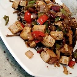 Hot and Spicy Tofu Recipe - Firm tofu, bell pepper, and red onion, all quickly stir fried in sweet and sour sauce. A word of caution - this is VERY spicy! If you like milder dishes, decrease the amount of pepper flakes or omit them altogether.