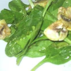 Spinach Salad with Curry Vinaigrette Recipe - Fresh spinach leaves are tossed with crisp-chewy cubes of bacon, sliced mushrooms and a homemade toasted curry vinaigrette.