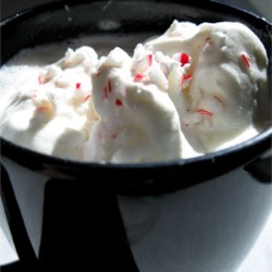 Snow Flake Cocoa Recipe - White chocolate cocoa heats in a slow cooker and is garnished with whipped cream and candy canes. The slow cooker is a great way to keep the cocoa warm for a crowd.