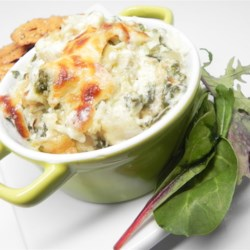 The Perfect Hot Artichoke and Spinach Dip Recipe - This rich and cheesy hot artichoke and spinach appetizer offers a flavor surprise: the mild heat of chopped fresh jalapeno! Goes great with sliced French bread!