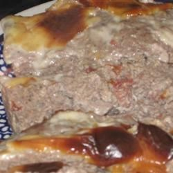 Tex Mex Meatloaf Recipe - Ground beef, eggs, and bread cubes are combined with canned diced tomatoes with green chilies, and seasonings, topped with your choice of cheese, and baked in a loaf pan for 1 hour.