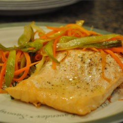 Salmon with Caramelized Leeks Recipe - Simple roasted salmon fillets get an elegant topping of caramelized leeks and matchstick carrots.
