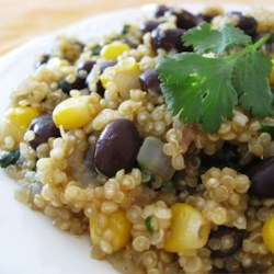 Quinoa and Black Beans Recipe - Whether you're trying quinoa for the first time or just trying a new recipe for quinoa, this mixture of quinoa, black beans, corn, and spices will make this dish a new favorite.