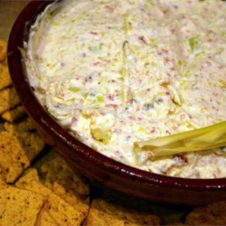 Leek Dip  Recipe - A mild, creamy dip that puts beloved leeks in the spotlight. Serve with buttery, round crackers. It's always a big hit at parties!