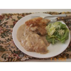 Skillet Chops with Mushroom Gravy Recipe - Here's a perky variation on pork chops and mushroom gravy. Coat the chops with a mixture of bread crumbs and Parmesan cheese before browning. Then simmer the chops in cream of mushroom soup.