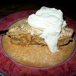 Butternut Brownie Pie Recipe -  For this unique recipe, the crust is made from graham crackers folded into sweetened whipped egg whites and spooned into a pie plate and baked. Then it 's crowned with flavored whipped cream and chopped pecans.