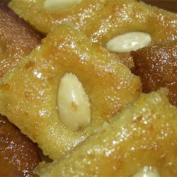 Basboosa Recipe - This is a traditional Middle Eastern dessert made with semolina and yogurt, then soaked in a rose water syrup. I got this recipe from my sister-in-law.