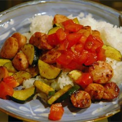 Smoked Sausage and Zucchini Saute Recipe - Quick and easy main dish. A good way to use up extra zucchini from the summer garden. My mother used to make this to keep the kitchen from getting too hot from the oven.  Serve over cooked rice.