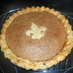 Quebec City Sugar Pie with Thick Cream Recipe - This version is the regional specialty at its finest. This lovely brown-sugar-and-egg mixture sets like pumpkin pie!  Serve in a pool of thick cream, which is the perfect complement to the rich, sweet dessert.