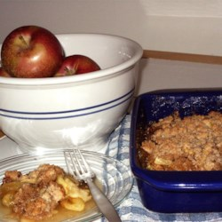 Best Apple Crisp Ever Recipe - A no-fuss, very delicious version of apple crisp, sliced apples, sugar, cinnamon and flour are stirred together and then piled into a square baking pan. Melted butter and a beaten egg, mixed with a flour, sugar and cinnamon mixture are spread over the top and the Best Apple Crisp Ever is baked in the oven until bubbly and crisp.