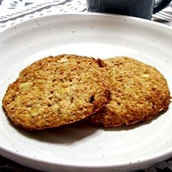 Digestive Biscuits Recipe - Similar to the traditional British biscuits, these can also be served buttered or with cheese.  For a sweeter biscuit, brush one side with melted semisweet chocolate after baking.