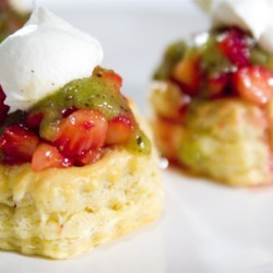 Strawberry Kiwi Tartlets Recipe - Glazed strawberries in puff pastry shells, topped with kiwi sauce and home made whipped cream. I always see strawberry and kiwi paired together in drink mixes and candies. I wanted to make something that used the actual fruits together. This worked perfectly. Rave reviews!