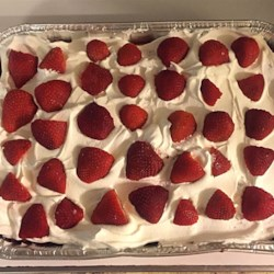 Triple Strawberry Cake Recipe - An incredibly moist and light cake made with cake mix, strawberry gelatin and fresh strawberries. Great for summer picnics and get-togethers. Can be made to be very low fat by using an egg substitute and applesauce instead of oil in the cake mix and using fat free topping.