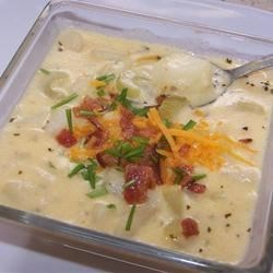 Nikki's Creamy Crock Pot Potato Soup Recipe - A creamy, flavorful potato soup, made in the slow cooker, gets extra flavor from bacon and cheese.