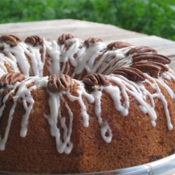 Honey Bun Cake I Recipe - This cake tastes just like the name suggests - like a honey bun. It has been served to hundreds of people and everyone has said how much they liked it. It is a sweet cake and not for those that are watching their weight. Tastes wonderful if served with a small scoop of vanilla ice cream.