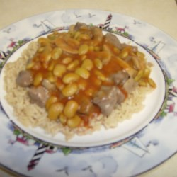Steak and Lima Rice Recipe - Steak is braised then served over rice topped with a tomato and lima bean sauce.