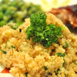 Quinoa Side Dish Recipe and Video - Quinoa is tossed with onion, garlic, and herbs. This may be served hot or at room temperature. It can also be cooked in chicken broth for added richness.