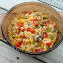 Orzo Delicioso Recipe - This fresh, colorful pasta dish features sauteed onions, garlic, mushrooms, corn, tomato, bell peppers, and fresh jalapenos in a light white wine sauce.