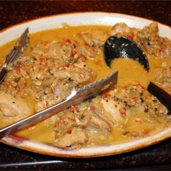 Guinataan Chicken Adobo Recipe - This Filipino dish features chicken stewed in a sauce with vinegar, soy sauce, garlic, and onion and is finished with coconut milk.