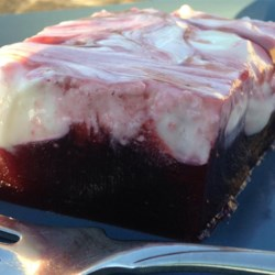 Sour Cream Cranberry Jell-O(R) Salad Recipe - A rich and flavorful gelatin salad combines sour cream with black cherry gelatin and jellied cranberry sauce.