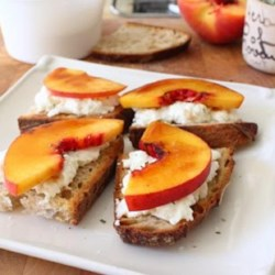 Peach Brulee Burrata Bruschetta Recipe and Video - Halfway between sweet and savory, these bruleed peaches on toast with Burrata cheese are the perfect appetizer for summer entertaining.