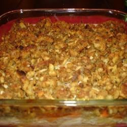 Gravy Stuffing Chicken Bake Recipe - Roasted chicken is baked again with canned vegetables, stuffing and gravy for a quick homestyle meal.