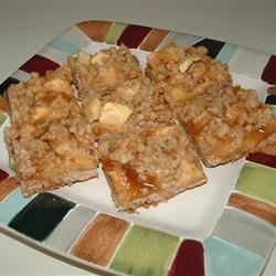 Caramel Apple Bars I Recipe - Caramel and apples make for delicious bars. Pecans in place of the walnuts would work equally as well.
