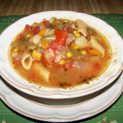 Spicy Vegetable Beef Soup Recipe - Chunks of beef are simmered with mixed vegetables, mushrooms, celery and pasta and seasoned with oregano, thyme, basil, parsley and cayenne.