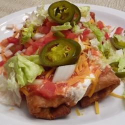 Shredded Beef Chimichangas Recipe - Usually deep fried, chimichangas can also be oven-fried with less mess, fuss, and fat. Use the filling in burritos as well. You may also deep fry, if desired.