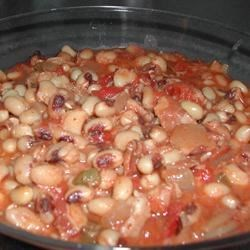 CB's Black Eyed Peas Recipe - Make these black-eyed peas, seasoned with bacon, tomatoes, and chili powder, in your slow cooker. They're perfect for New Year's Day, or whenever you want an easy, hearty meal.