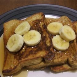 Peanut Butter French Toast Recipe - If you love French toast and you love peanut butter, why not combine them into one easy, delish recipe? Top with sliced strawberries or bananas.