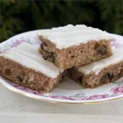Applesauce Bars Recipe - Moist and spicy bar cookies with frosting. An easy and quick after school snack that is also perfect for carry-ins and bake sales.