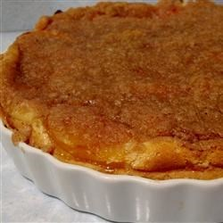 Old-Fashioned Peach Cream Pie Recipe - Peach slices bake in a sour cream custard in this old-fashioned crumb-topped pie.