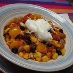 Mexican Bean Stew Recipe - Pinto, black and garbanzo beans are simmered with fresh corn, tomatoes and savory spices.  This recipe calls for dry beans, which will need to soak overnight.