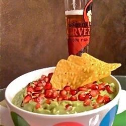 World's Best Guacamole Recipe - Pomegranate seeds replace tomatoes in this guacamole recipe.