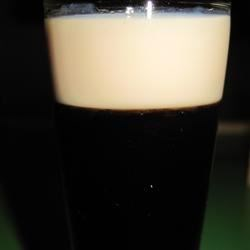 Baby Guinness Recipe - A delicious shooter that looks like a mini-pint of Guinness. Also learned this one in London.